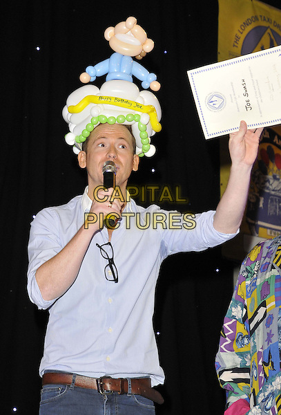 LONDON, ENGLAND - JANUARY 19: Joe Swash at the Mad Hatter's Tea Party organised by the London Taxi Drivers' Fund to help underprivileged children, Grosvenor House Hotel, Park Lane, on Sunday January 19, 2014 in London, England, UK. <br /> CAP/CAN<br /> &copy;Can Nguyen/Capital Pictures