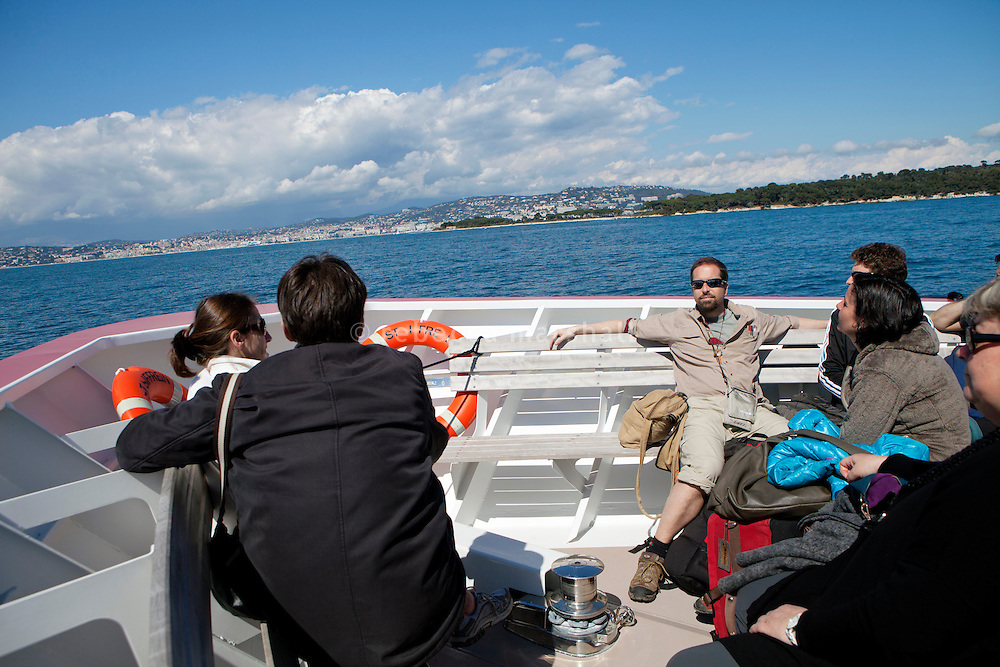 On board the ferry back to Cannes from Ile Saint Honorat, France, 3 April 2013. Ile Sainte Marguerite, the larger of the two islands that make up the Iles de Lérins, is in the background (right).