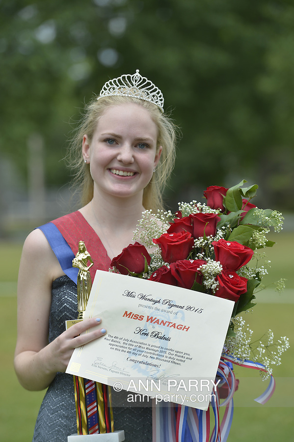 Wantagh, New York, USA. 4th July 2015. KERI BALNIS, Miss Wantagh 2015, holds the trophy, bouquet of roses, and certificate award she received as winner of The Miss Wantagh Pageant ceremony, a long-time Independence Day tradition on Long Island, held at Wantagh School after the town's July 4th Parade. Since 1956, the Miss Wantagh Pageant, which is not a beauty pageant, crowns a high school student based mainly on academic excellence and community service.