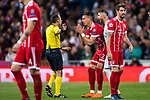 Sandro Wagner of FC Bayern Munich talks to referee Cuneyt Cakir during the UEFA Champions League Semi-final 2nd leg match between Real Madrid and Bayern Munich at the Estadio Santiago Bernabeu on May 01 2018 in Madrid, Spain. Photo by Diego Souto / Power Sport Images