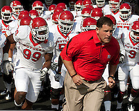 Rutgers head coach Greg Schiano leads his team onto the field. The Pittsburgh Panthers defeated the Rutgers Scarlet Knights 41-21 on October 23, 2010 at Heinz Field, Pittsburgh, Pennsylvania....