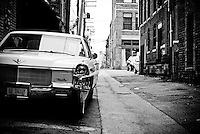 Urbane Alleyway in Birmingham Alabama witha Car that stands out against the normal.