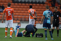 Danny Rowe of Wycombe Wanderers goes down injured again during the Sky Bet League 2 match between Blackpool and Wycombe Wanderers at Bloomfield Road, Blackpool, England on 20 August 2016. Photo by James Williamson / PRiME Media Images.