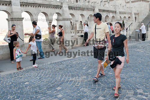 Tourists walk in the Castle of Buda on summer sightseeing in Budapest, Hungary on August 25, 2011. ATTILA VOLGYI