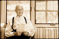 Elderly man reading.