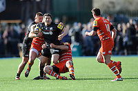 Scott Spurling of Saracens is tackled by Leonardo Ghiraldini of Leicester Tigers during the Aviva Premiership Rugby match between Saracens and Leicester Tigers at Allianz Park on Saturday 11th April 2015 (Photo by Rob Munro)