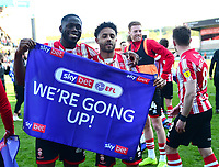 Lincoln City's John Akinde, left, and Bruno Andrade celebrate promotion at the end of the game<br /> <br /> Photographer Andrew Vaughan/CameraSport<br /> <br /> The EFL Sky Bet League Two - Lincoln City v Cheltenham Town - Saturday 13th April 2019 - Sincil Bank - Lincoln<br /> <br /> World Copyright &copy; 2019 CameraSport. All rights reserved. 43 Linden Ave. Countesthorpe. Leicester. England. LE8 5PG - Tel: +44 (0) 116 277 4147 - admin@camerasport.com - www.camerasport.com