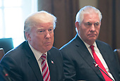 United States President Donald J. Trump speaks to the media during a meeting with Amir Sabah al-Ahmed al-Jaber al-Sabah of Kuwait at The White House in Washington, DC, September 7, 2017.  At right is US Secretary of State Rex Tillerson. <br /> Credit: Chris Kleponis / Pool via CNP