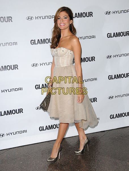 EVA MENDES .at The Glamour Reel Moments Presented by Hyundai, the Series of Short Films Written and Directed by Women in Hollywood held at The Directors Guild of America in West Hollywood, California, USA, .October 25th 2010..full length strapless cream beige  dress bustier grey gray silver shoes clutch bag                                         walking .CAP/RKE/DVS.©DVS/RockinExposures/Capital Pictures.