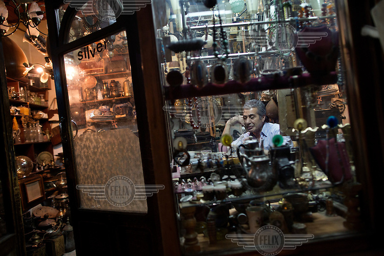 The owner of a tourist shop talks on the phone, in old town of Damascus, Syria. The old town would have once bustled with tourists but with the ongoing conflict engulfing the country tourism has completely dried up.