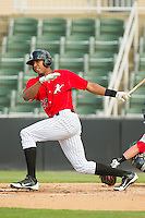 Juan Ramirez (28) of the Kannapolis Intimidators follows through on his swing against the Greenville Drive at CMC-Northeast Stadium on June 29, 2013 in Kannapolis, North Carolina.  The Intimidators defeated the Drive 9-3 in the completion of the game that began on June 28, 2013.   (Brian Westerholt/Four Seam Images)