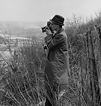 Pittsburgh PA:  View of Ross Catanza, Brady Stewart Studio Photographer, taking a photograph of the city - 1962. <br />