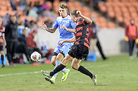 Houston, TX - Friday December 9, 2016: Nils Bruening (14) of the North Carolina Tar Heels and Tanner Beason (3) of the Stanford Cardinal battle for control of a loose ball at the NCAA Men's Soccer Semifinals at BBVA Compass Stadium in Houston Texas.