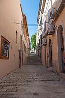 A narrow street in the city of Pula, Istria County, Croatia
