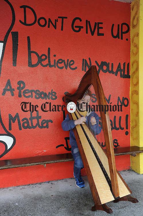 Eoin Treanor of Claremorris, Co Mayo practicing on his harp before competing at Fleadh Cheoil na hEireann in Ennis. Photograph by John Kelly.