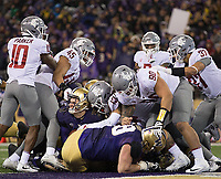 Jake Browning gets an extra tug on the facemask after scoring a touchdown.