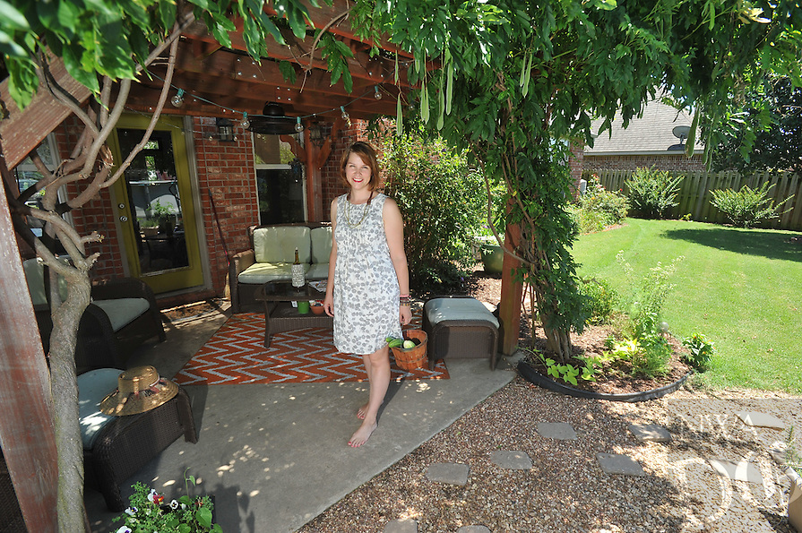 NWA Democrat-Gazette/MICHAEL WOODS &bull; @NWAMICHAELW<br /> Vanessa Ryerse  June 28, 2016 in her favorite space on her back porch in Springdale.