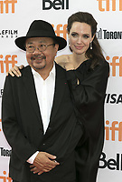 www.acepixs.com<br /> <br /> September 11 2017, Toronto<br /> <br /> Rithy Panh and Angelina Jolie arriving at the premiere of 'First They Killed My Father' during the 42nd Toronto International Film Festival at the Princess of Wales Theatre on September 11 2017 in Toronto, Canada<br /> <br /> <br /> By Line: Famous/ACE Pictures<br /> <br /> <br /> ACE Pictures Inc<br /> Tel: 6467670430<br /> Email: info@acepixs.com<br /> www.acepixs.com