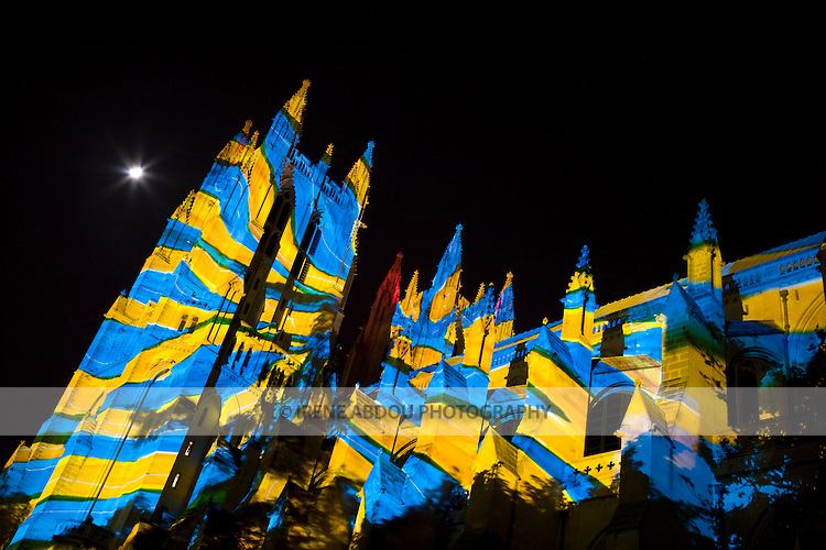 "The Washington National Cathedral's role as spiritual beacon for the nation is highlighted under the technical artistry of Gerry Hofstetter, Swiss lighting artist, during the Cathedral's centennial ""Lighting the Nation, Uniting the World"" event."