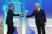 United States President Barack Obama (L) shakes hands with former US President Bill Clinton (R) at the Clinton Global Initiative (CGI) in New York, New York, USA, Thursday, 23 September 2010. President Obama joined sixty-four current and former heads of state in attending the sixth annual meeting of the CGI.  The commitment of CGI members has improved the lives of more than 220 million people in 170 countries, according to President Bill Clinton.  The 2010 meeting features a session on 'Peace and Beyond in the Middle East'.  .Credit: Michael Reynolds - Pool via CNP