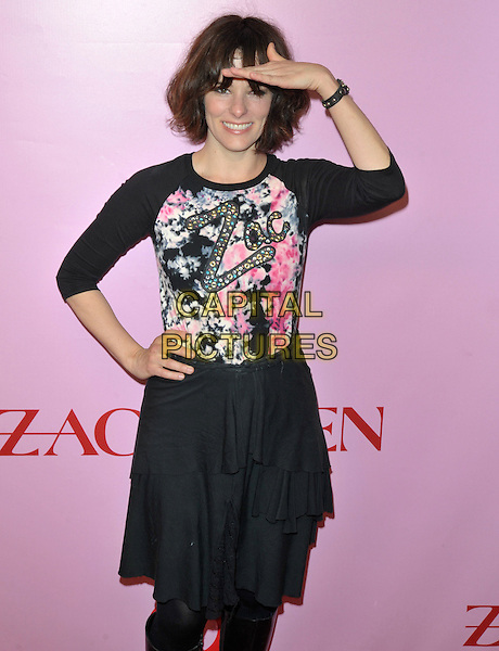 PARKER POSEY.Zac Posen For Target Collection Launch held at the New Yorker Hotel, New York, NY, USA, 15th April 2010..half length black slogan logo print top skirt smiling hand on hip salute looking gesture  tiered .CAP/ADM/BM.©Bill Menzel/AdMedia/Capital Pictures.