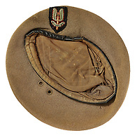 BNPS.co.uk (01202 558833)<br /> Pic: Bosleys/BNPS<br /> <br /> Caseys 1st SAS beret alone sold for £4000.<br /> <br /> Sold for £25,000 - An extraordinary wartime archive that lift's the veil on the earliest days of the SAS during WW2.<br /> <br /> The late Fred Casey was among the original dozen members of the 1st Special Air Service that was formed in North Africa to wreak havoc behind enemy lines.<br /> <br /> The commando's military possessions included a remarkable album containing previously unseen images of the founding members of the elite force.<br /> <br /> Legendary Captain David Stirling, who formed the 'Who Dares Wins' regiment, and hand-picked the men under his command, is pictured along with his controversial deputy Paddy Mayne , who took over the top secret regiment after Stirling's capture.<br /> <br /> The album sold at Bosley's Auctioneers of Marlow, Bucks, last week for over five times its pre-sale estimate..