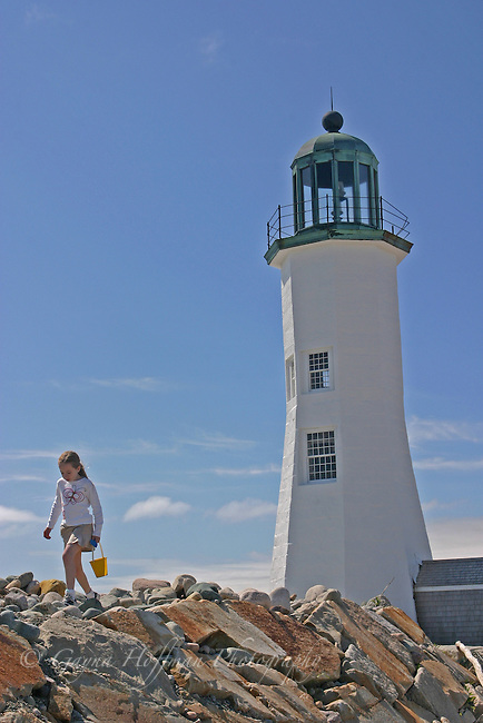 coastal,Caucasian,young girl with sand bucket.Scituate Lighthouse, Scituate,sunny,New England, MA, U.S.,vacation,vertical,summer,