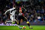 Toni Kroos of Real Madrid (L) fights for the ball with Luis Advincula of Rayo Vallecano during the La Liga 2018-19 match between Real Madrid and Rayo Vallencano at Estadio Santiago Bernabeu on December 15 2018 in Madrid, Spain. Photo by Diego Souto / Power Sport Images