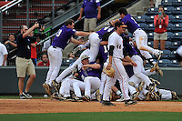 Members of the Western Carolina Catamounts jump on the victory dog pile following walk-off 3-2 win against Mercer in the SoCon Tournament championship final on Sunday, May 29, 2016, at Fluor Field at the West End in Greenville, South Carolina. (Tom Priddy/Four Seam Images)