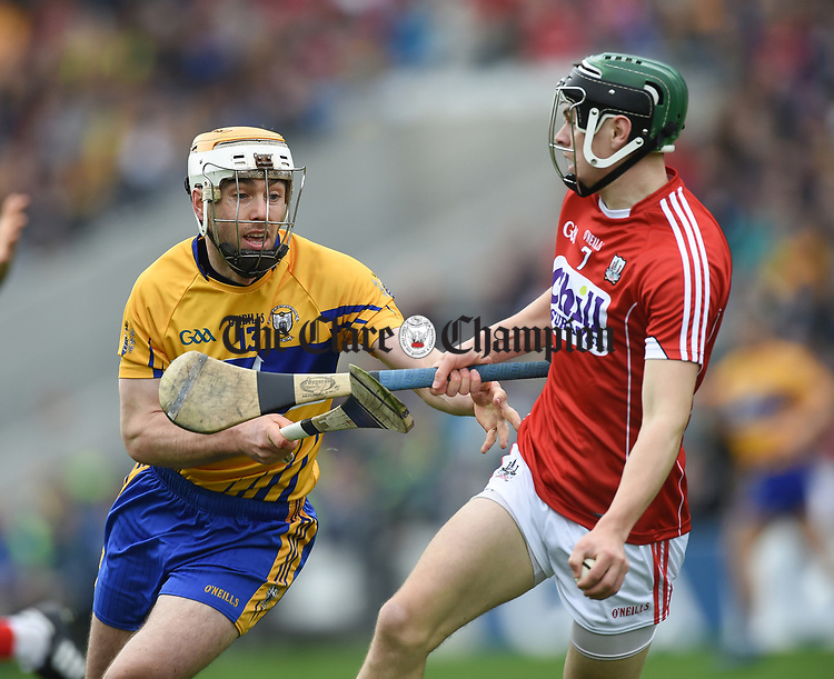 Conor Mc Grath of Clare in action against Mark Coleman of Cork during their Munster Senior game at Pairc Ui Chaoimh. Photograph by John Kelly.