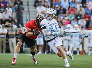 Baltimore, MD - April 28, 2018: Johns Hopkins Blue Jays Cole Williams (14) attempts a shot during game between John Hopkins and Maryland at  Homewood Field in Baltimore, MD.  (Photo by Elliott Brown/Media Images International)
