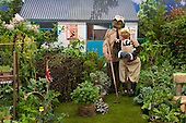 Saturday, 18 May 2013, London, UK. Planting and contruction work continues for the Chelsea Flower Show 2013 ahead of its opening next week. Picture: Generation Gardens with scarecrows made by school children.