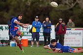 Ray Laulala kicks an early penalty with assistance from Louis Kapeteni. Counties Manukau Premier Club Rugby game between Patumahoe and Ardmore Marist, played at Patumahoe on Saturday July 9th 2016.<br /> Ardmore Marist won the game 33 - 24 after leading 18 - 12 at halftime. Photo by Richard Spranger.