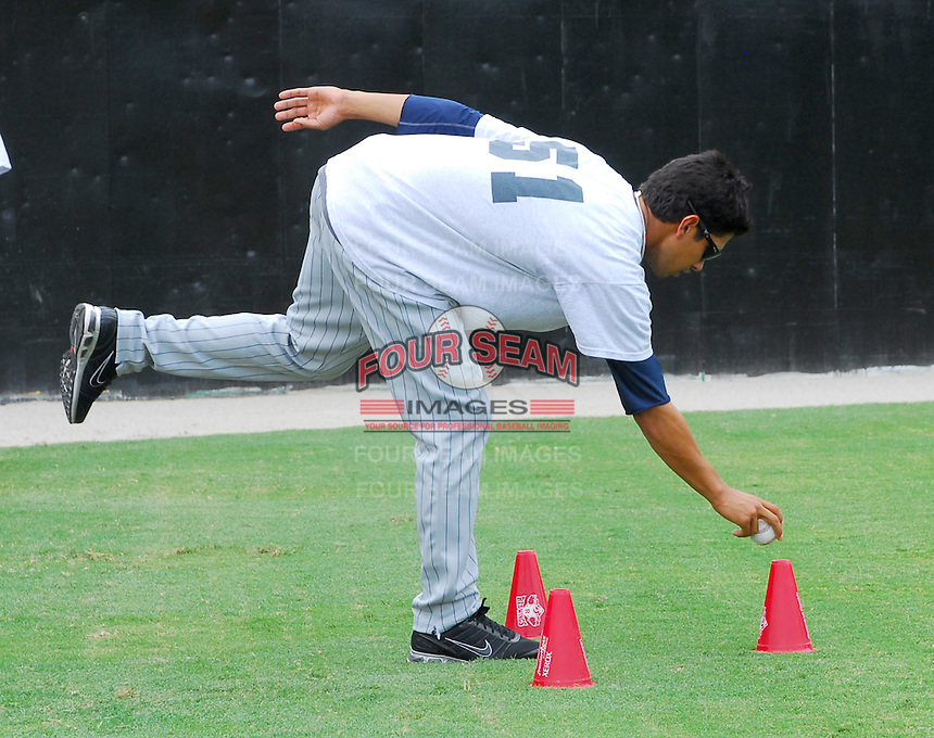 July 15, 2009: RHP Miguel Munoz (51) of the Elizabethton Twins works on a balance and agility drill prior to a game against the Danville Braves at Dan Daniel Memorial Park in Danville, Va. Photo by:  Tom Priddy/Four Seam Images