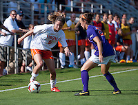 Morgan Brian (6) of Virginia moves past Emily Byorth (28) of Clemson at Klockner Stadium in Charlottesville, VA.  Virginia defeated Clemson, 3-0.