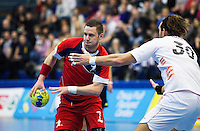 08 JAN 2012 - LONDON, GBR - Great Britain playmaker Chris Mohr (#7, in red) looks for a way through the Austrian defence during the men's 2013 World Handball Championships qualification match at the National Sports Centre in Crystal Palace, Great Britain .(PHOTO (C) 2012 NIGEL FARROW)