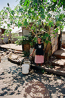 Young woman in shanty town alongside Congressional Building, Asuncion, Paraguay.