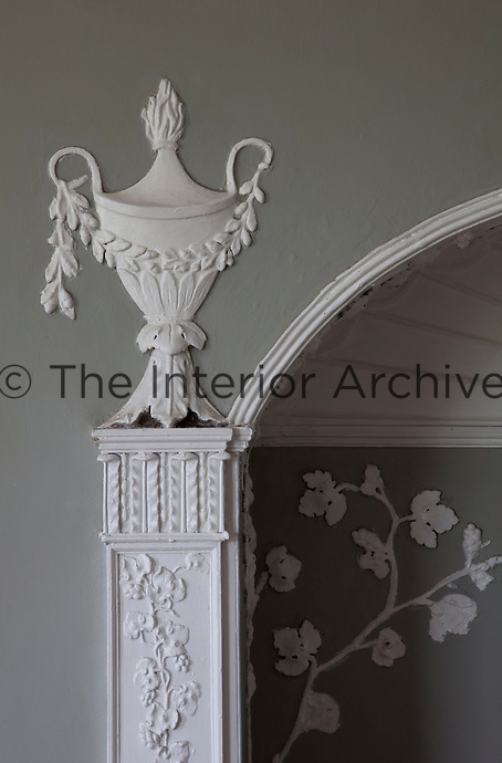 A plasterwork urn on the alcove in the drawing room