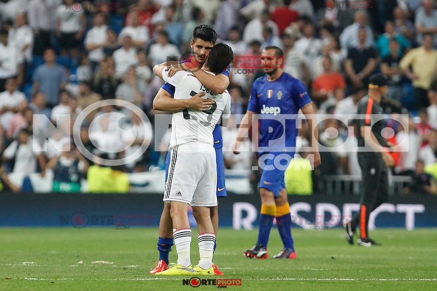 Real Madrid´s Isco hugs Alvaro Morata after the Champions League semi final soccer match between Real Madrid and Juventus at Santiago Bernabeu stadium in Madrid, Spain. May 13, 2015. (ALTERPHOTOS/Victor Blanco) /NortePhoto.COM