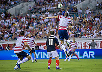 May 26, 2012:  USA Men's National Team d Oguchi Onyewu (5) heads the ball while being defended by Scotland Shaun Maloney (11) during action between the USA and Scotland at EverBank Field in Jacksonville, Florida.  USA defeated Scotland 5-1.............