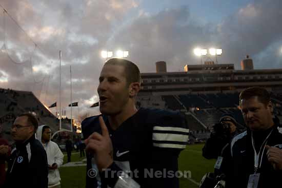 """BYU's Max Hall (15) says to the crowd, """"One more game,"""" as he walks off the field following the win. BYU vs. Air Force college football Saturday, November 21 2009."""