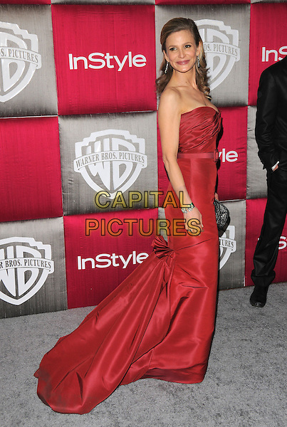 KYRA SEDGWICK .The 10th Annual Instyle & WB Golden Globes After Party held at Oasis Court in The Beverly Hilton Hotel in Beverly Hills, California, USA..January 11th, 2009.full length red strapless dress gown belt .CAP/DVS.©Debbie VanStory/Capital Pictures.