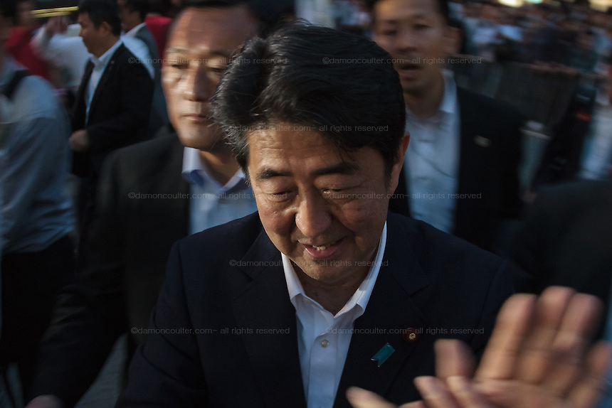 Japanese Prime Minister, Shinzo Abe meets supporters of Liberal Democratic Party candidate, Junko Mihara at an election rally in Sakuraguicho, Yokohama, Kanagawa, Japan. Monday June 27th 2016. The Japanese house of Councillors (Upper House) will hold an election on July 10th.