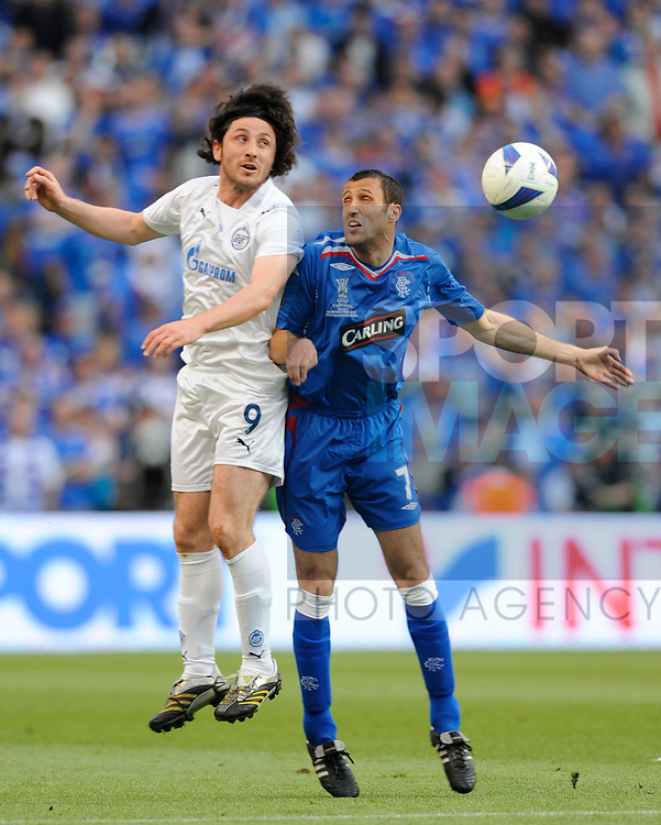 Fatih Tekke of Zenit St Petersburg and Brahim Hemdani of Rangers during the Europa League Final match at The Etihad Stadium, Manchester. Picture date 14th May 2008. Picture credit should read: Simon Bellis/Sportimage