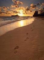 Footprints Leading into Sunset, Waimanalo Beach, Oahu, Hawaii, USA.