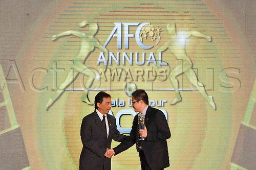 26.11.2013  Kuala Lumpur.  Liu Yongzhuo, team manager of Guangzhou Evergrande (R), receives the AFC Club of the Year award trophy from Prince Abdullah Ibni Sultan Ahmad Shah, Vice President of the Asian Football Confederation at the AFC Foreign Player of the Year ceremony in Kuala Lumpur, Malaysia, on Nov. 26, 2013.