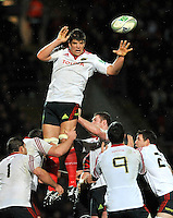 Watford, England. Donncha O'Callaghan of Munster  Donncha O'Callaghan of Munster clears the line out  during the Heineken Cup match between Saracens and Munster Rugby at the Vicarage Road on December 16, 2012 in Watford, England.