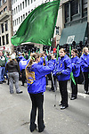 March 16, 2013 - New York, NY, U.S. - A flag twirler gets ready to march in the 252nd annual NYC St. Patrick's Day Parade. Thousands of marchers show their Irish pride, as they march up Fifth Avenue, and over a million people, often in green and orange, watch and celebrate. Those marching, many who wore kilts, uniforms, colorful costumes, sashes, included Bag and Pipe Bands; Irish dancers; fire, police, military, religious, educational, and social groups.
