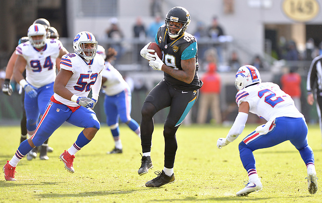 Jacksonville Jaguars tight end Marcedes Lewis (89) makes a 16 yard catch between Buffalo Bills linebacker Preston Brown (52) and safety Micah Hyde (23) with 635 to play in the third quarter in a NFL Wildcard Playoff game Sunday, January 7, 2018 in Jacksonville, Fl.  (Rick Wilson/Jacksonville Jaguars)