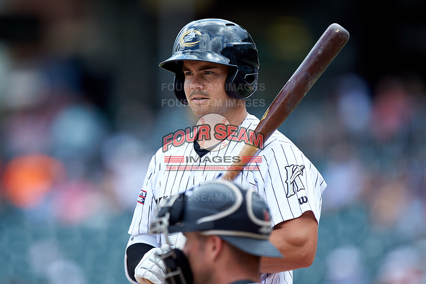 Brett Austin (22) of the Charlotte Knights checks the signs with the third base coach during the game against the Indianapolis Indians at BB&T BallPark on August 22, 2018 in Charlotte, North Carolina.  The Indians defeated the Knights 6-4 in 11 innings.  (Brian Westerholt/Four Seam Images)